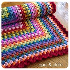 Traditional granny square baby blanket in gorgeous vintage rainbow colours.