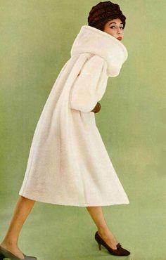 1959 Model in white textured wool coat by Pierre Cardin