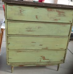 Distressed green dresser with barnwood top painted with miss mustard seed lucketts green