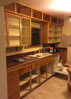 If you have some old cabinet doors laying around or your neighbor is getting ready to upgrade their kitchen, grab some doors and put them to good use.