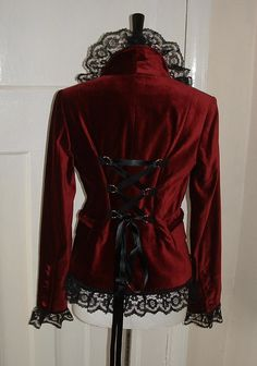 Make a Steampunk jacket from an old velvet jacket: by adding lace to cuffs, collar, hem, and corset lacing to back.