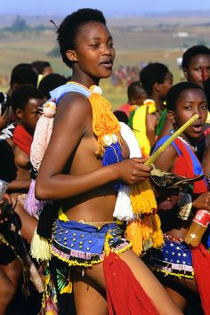 Zulu girls attend Umhlanga, the annual Reed Dance festival of Swaziland.