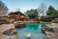 Gorgeous home on a .45 acre CDS lot with private BY paradise with pebbeltech pool, spa, waterfall, stream, outdoor covered living center with FP, blt-in grill & smoker & a big gated side yard with separate access. Custom appointments, 4BR, 4 full bath & 2 half baths, 4 fireplaces, chef's kitchen with Dacor c-top, double ovens, built-in Sub Zero Ref, dry butler & walk in pantry! Mstr, Guest & Study down,wine area,wet bar, game, media & craft room!|strip_tags