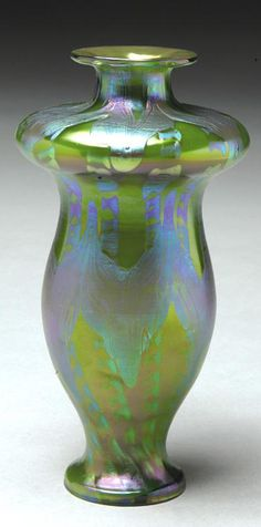 Loetz iridescent glass vase, circa 1901-03,  swelling ogee form, with vividly colored trailed decoration in tones of blue, green, and violet, unsigned, H. 8 1/2 in.