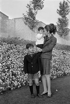 Empress Farah with her sons Crown Prince Reza and Prince Ali-Reza in the gardens of Niavaran Palace, 1967.