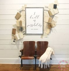 Custom book wall from @simplysoutherncottage. With theater seats and Emily Dickinson quote.