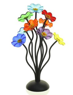 Nine-Flower Bouquet in Prism Colors by Scott Johnson and Shawn Johnson. Nine glass flowers sit atop sculpted aluminum stems in this perfect table centerpiece. Flower colors are a mixture of bright jewel tones in red, green, purple, blues, yellow and orange. Artist has named this color combination
