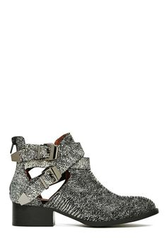 Totally necessary black and white lizard leather ankle boots featuring side cutouts and strapped detailing with gunmetal buckles.