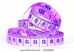 Tailor's measuring purple tape on white background