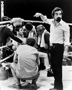 Raging Bull (1980) behind the scenes in the boxing ring with filmmaker Martin Scorsese and lead actor Robert De Niro.