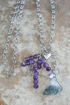 Amethyst activates the Third Eye and Crown Chakras, enhances intuition and psychic abilities, and creates a strong healing field around the user. It also cleanses the aura, promotes spiritual healing, deepens the meditative state, removes resistance to change and transmutes lower vibrations to higher love frequencies. The Purple Agate also carries the Violet Flame and energies, as well as brings in an Earthy, grounding energy.