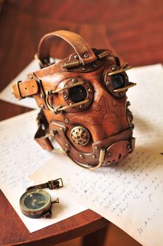 For those adventures into the bowels of an airship to replace an engine part ... this mask protects you from the deadly environment therein.    http://fc05.deviantart.net/fs70/f/2011/126/d/7/leather_steampunk_gas_mask__by_denbow-d3fpp60.jpg