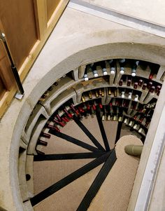 Composite House interior spiral wine cellar