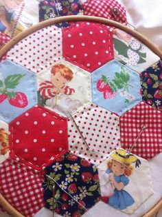 hand quilting hexies - love the use of prints in this