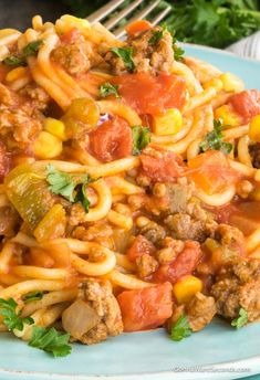 Our Easy Mexican Spaghetti Recipe is a delicious One Pot wonder! Filled with beef, pasta, tomatoes, corn and taco seasoning, this is a meal the whole family will love! Its also finished with a cheesy topping. Mexican Spaghetti is perfect for a busy weeknight dinner.