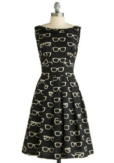 Stop, and stare at the fantastic Frames and Fortune Dress. Its brilliant print of brainy specs is what landed this flirty frock as the top ModCloth dress of 2012. Cheers, and here's to a new year of dresses!