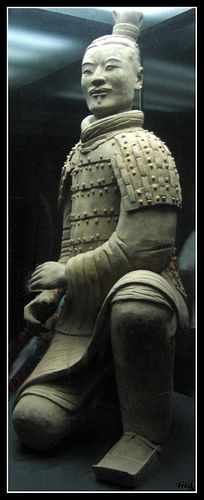 Terra-cotta warrior Xi'an China. This is a kneeling archer. I have 2 of them, plus a general,   I which I bought in Xi'an in 1998. Sadly, they are outside in my yard and falling apart.