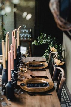 Fall Tablescape Inspiration : Matte black bottles, rose gold candles, gold candles, dark wood, eucalyptus, champagne. | repinned by @wolfandirving