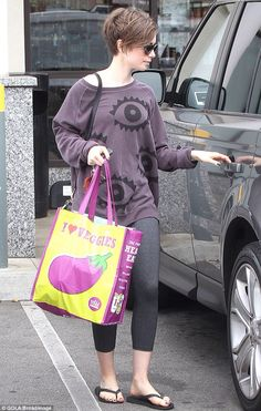 Lily Collins sports low-key workout gear and stocks up on groceries as she settles back into normality after the Met Gala
