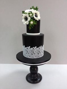 Trending right now: Black fondant wedding cakes with sugar veil lace and sugar anemones.