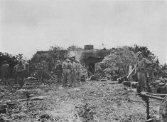 US Marines resting in front of a recently destroyed Japanese blockhouse, Peleliu, Palau Islands, 16 Sep 1944