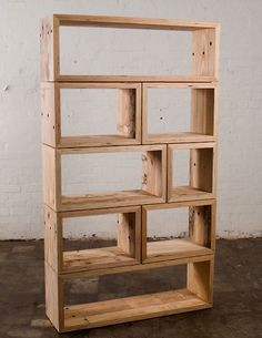 We really like the asymmetry of these book shelves by Melbourne based furniture maker/designer Mark Tuckey. Made from recycled packing crate wood, the different shaped boxes create a frame-like effect perfect for storing thoughtfully edited collections of books or objects.