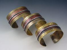 Cuffs | Michele Grady. Sterling silver, copper and brass.