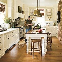 White walls, white cabinets. Island with dark butcher block top. Black hardware. Wood floors. This is it!