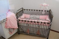 Pink and gray crib bedding would be perfect in an elegant white crib.
