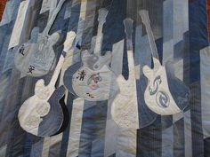 Recycled jeans made into quilt - love the guitars! Jean Crafts, Denim Crafts, Denim Quilt Patterns, Denim Quilts, Bag Patterns, Blue Jean Quilts, Denim Art, Diy Jeans, Textiles
