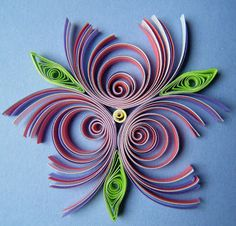 Quilliance~ I'm really not sure whether I've seen this idea somewhere before, or whether it just popped out of my head ... but I wanted to see what would happen when you cut through some of the outer rings of multi-strip eccentric coils - and this little flower is the result: