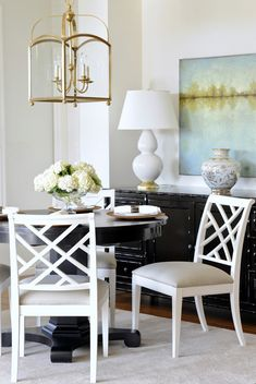white chairs, black pedestal, gold lantern