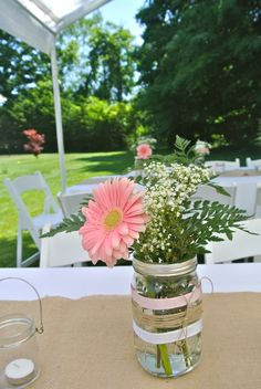 Centerpieces for our rustic country bridal shower. Mason jars decorated with lace, ribbon, and burlap filled with pink gerber daisies, white daisies, and babies breath!