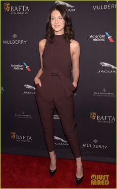 Caitriona Balfe in a Cameo jumpsuit, Stuart Weitzman heels, a Saint Laurent bag, and Catbird jewelry.