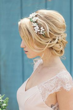 messy updo wedding hairstyle with flower crown