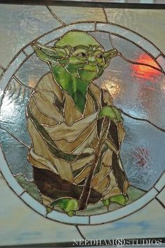 I'm not a Yoda fan, nor would i make this, but the choice of glass is amazing! This is fabulous work!