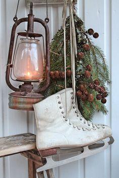 Ice skates, lantern, & greens. VIBEKE DESIGN