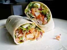 Buffalo Chicken Salad Wrap - Lunch Idea. Leftover baked chicken, tossed in buffalo sauce, wrapped up with some cheese, croutons, lettuce, carrots, tomato & a little ranch or blue cheese.