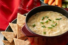 Hot Cheesy Crab Dip recipe - Kick off the party with a hot and melty dip -- a must at any holiday gathering! #appetizers