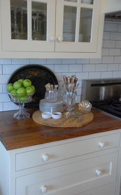 Subway tile with dark grout Mary Carol Garrity's Cottage Kitchen With Wood Countertops and Subway Tile