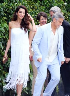 Amal Clooney Wows in  a layered 1960's White Fringe Dress by William Vintage that featured thin straps and gold beading at the neckline