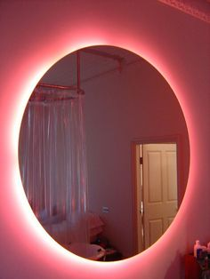 Pink Neon bathroom mirror this is kool would be nice to take a bath and relax