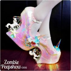 These ZombiePeepshow Pegasus platform curved heel less wedges are customized with unicorns, crystal spikes, lace, glitter, and iridescent finish.