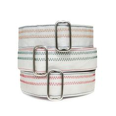 Dog collars made from old sails are perfect for the hound who enjoys feeling their ears flapping in the wind as they sail away on their next adventure!  Each collar tells it's own unique story, whether it's a wrinkle from an intense regatta race or a tale from a moonlit voyage through tropical waters, each collar shares it's experiences navigating the 7 seas!  We can't think of a better use for retired sails then recycling them into super sturdy and stylish dog collars!