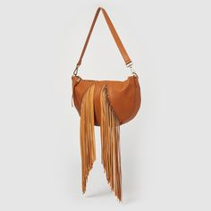 Champion is the ultimate boho chick crossbody with a slouchy silhouette, long fringes and interchangeable straps. Features include one woven pattern strap and one plain to make this bag fun and versatile. The Champion is crafted in textured vegan leather. Vegan Handbags, Long Fringes, Leather Handle, Saddle Bags, Vegan Leather, Bucket Bag, Champion, Urban