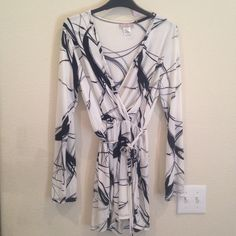 Shorts/Romper graphic print long sleeved NWOT Brand-new, never worn. Super cute fashion romper. Black-and-white with tie belt. Love the front cute with Cami under or without! Shorts