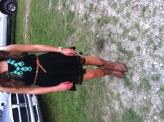 Black lace dress, turquoise bubble necklace, and tan cowboy boots! Country wedding, ready!