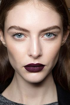 Aubergine lips for fall look.