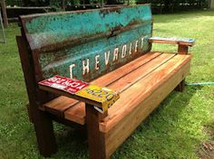 Garden Bench with an old tailgate. Love the license plates on the arms.
