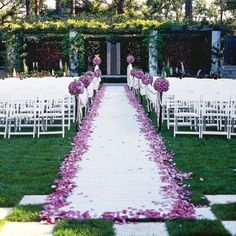 Garden Ceremony in Lovely Lavender. *love the petals around the 'carpet'